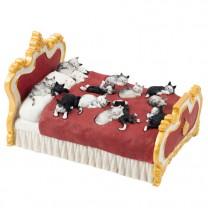 Des chats sur un lit Dubout